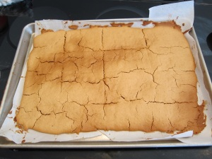 The longer it bakes, the more cracks it gets. At 20, and with better defined scoring between the crackers, those cracks everywhere would ...not have been all everywhere, I don't think!