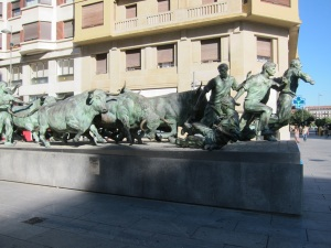 A statue depicting the running of the bulls, in Pamplona.