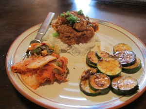 The daeji bulgogi in the back, kimchi on the left, and garlic/soy zucchini on the right.