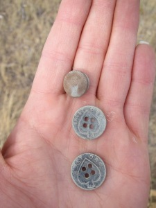 I found two buttons and a snap at a 1919 homestead!